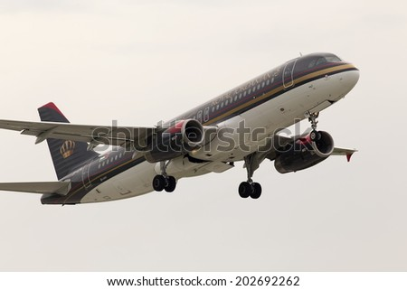 Borispol, Ukraine - May 18, 2014: Royal Jordanian Airbus A320-232 aircraft departing in the rainy day from the Borispol International Airport on May 18, 2014.