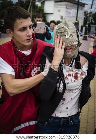 BORISPYL, KIEV REGION, UKRAIN - Sept 12, 2015:P Indicative training emergency doctors was held in Borispol. Doctors worked through action to rescue victims of the terrorist attack on the city bus. - stock photo