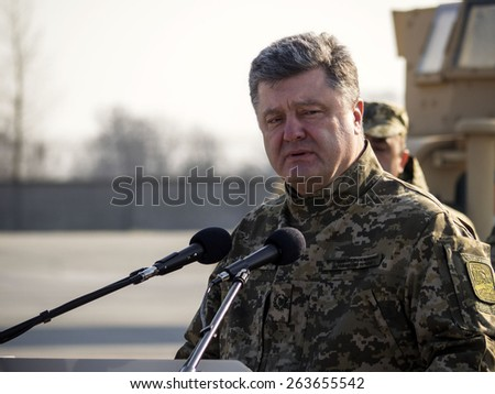 "BORISPYL, KIEV, UKRAINE - MARCH 25, 2015: President Petro Poroshenko met military aircraft of the Air Force with the first batch of US armored vehicles at the international airport ""Borispol""."