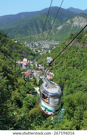 BORJOMI, GEORGIA - AUGUST 14, 2014: Town view from the aerial tram. The resort town Borjomi in south-central Georgia is famous for its mineral water, which is the number one of the export of Georgia. - stock photo