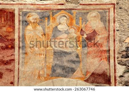 BORMIO, ITALY - FEBRUARY 6, 2015: Religion medieval fresco on the church wall in Bormio, Italy - stock photo