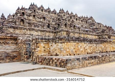 Borobudur Buddhist temple with Stone Carving, Magelang,  Java, Indonesia - stock photo