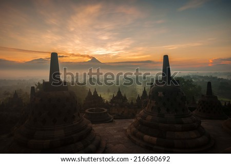 Borobudur Temple at sunrise, Yogyakarta, Java, Indonesia. (silhouette scene) - stock photo
