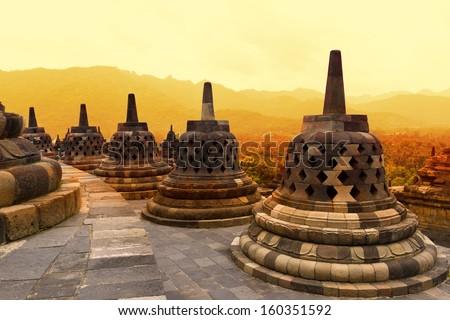 Borobudur Temple at sunset. Ancient stupas of Borobudur Temple. Yogyakarta, Central Java, Indonesia.  - stock photo