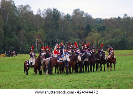 BORODINO, MOSCOW REGION, RUSSIA - SEPTEMBER 02, 2012: Reenactors dressed as Napoleonic war soldiers ride horses at Borodino battle historical reenactment.