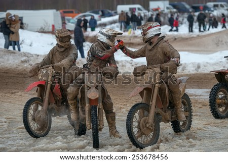BORODINO, RUSSIA - FEBRUARY 1: Unidentified riders after the finish of the All-Russian motocross named VP Chkalov on February 1, 2015 in Borodino, motor track motorcycle club Gallaks, Russia - stock photo