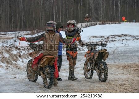 "BORODINO, RUSSIA - FEBRUARY 1: Unidentified riders talk after the All-Russian motocross named VP Chkalov on February 1, 2015 in Borodino, motor track motorcycle club ""Gallaks�», Russia - stock photo"