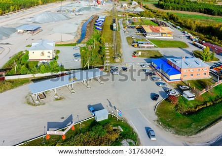 Borovskiy, Russia - September 16, 2015: Automatic gas-filling station and warehouse of liquefied hydrocarbonic gas. Russian text - Filling and repair of gas cylinders. Logos are erased. Tyumen region