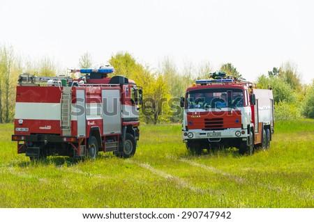 BORYSPIL, UKRAINE - MAY, 20, 2015: Red firetruck Tatra ride on call fire suppression and mine victim assistance at Boryspil International Airport, Kiev, Ukraine - stock photo
