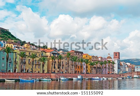 Bosa riverfront with boats on a cloudy day - stock photo