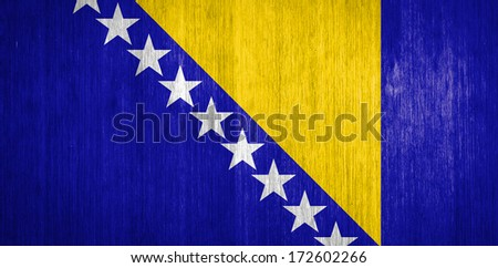 Bosnia and Herzegovina Flag on wood background - stock photo
