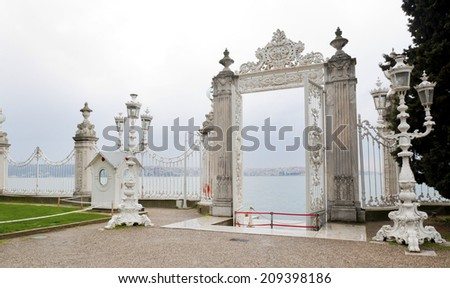 Bosporus, Istanbul,  Dolmabahce palace with ottoman columns of fence and gate - stock photo