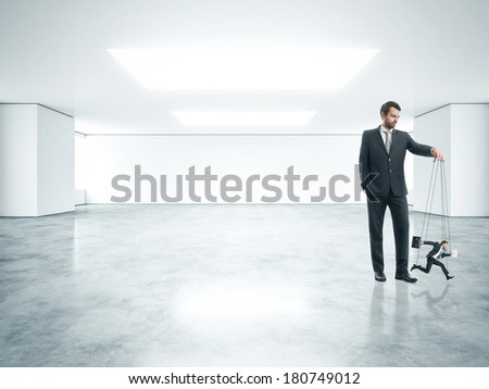 Boss and his marionette - stock photo