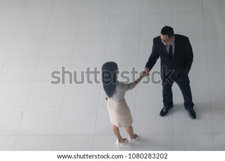 Boss secretary shaking hands greet each stock photo 1080283202 boss and secretary are shaking hands to greet each other at the lobby of the office m4hsunfo