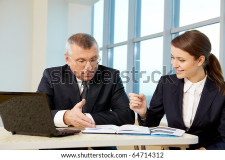 Boss and secretary planning work in office - stock photo