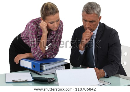 Boss explaining point to colleague - stock photo