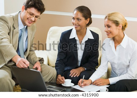 Boss is explaining the correct way of analysis to his people in working environment - stock photo