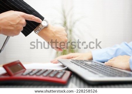 boss is pointing to the watch, he is late with work, pressure on workplace - stock photo