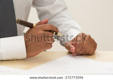 Boss is ready to sign a contract. - stock photo