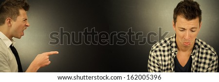 Boss pointing and yelling to his employee - stock photo
