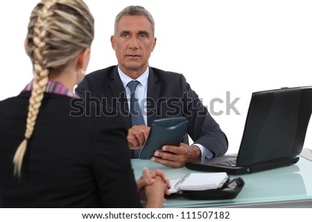 Boss setting agenda with assistant - stock photo