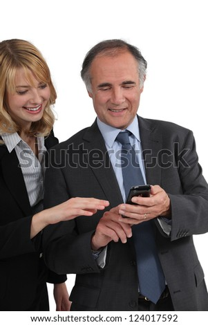 Boss showing a text message to his employee - stock photo