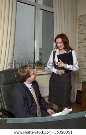 Boss sitting on chair - stock photo