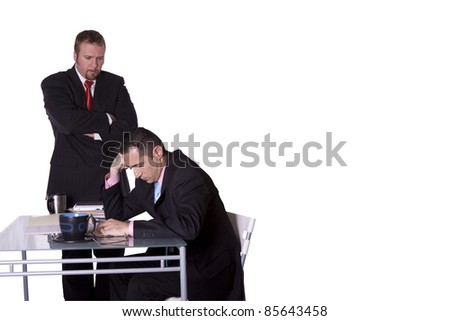 Boss Watching Over his Employee's Shoulder - With Copy Space - stock photo
