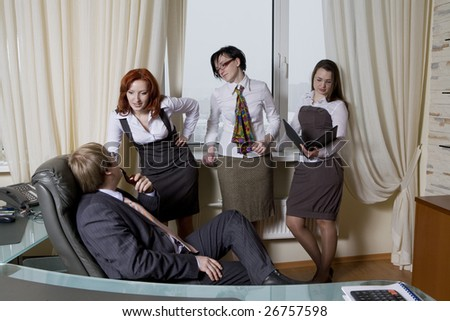 Boss with his women colleagues. Sexual harassment. Office people