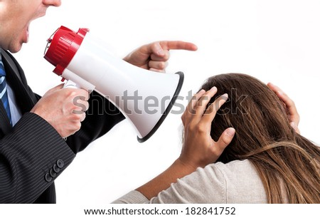 Boss with megaphone shouting at his employee - stock photo