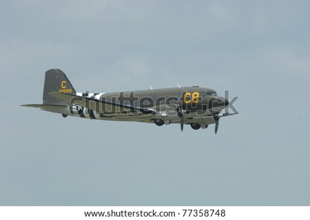 """BOSSIER CITY, LA - MAY 8: A World War II C-47 """"Dakota"""" performs a flypast at the Barksdale AFB airshow on May 8, 2011 in Bossier City, LA. - stock photo"""