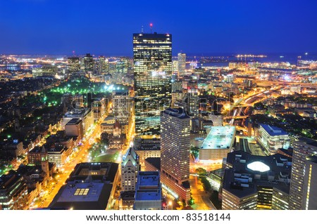 Boston aerial view with skyscrapers at dusk with city skyline illuminated. - stock photo