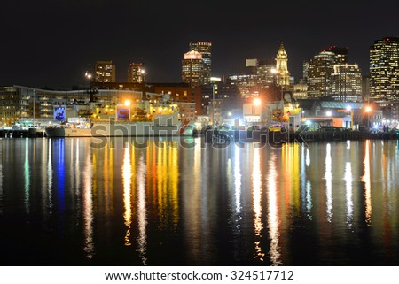 BOSTON - APR 14: Boston City Skyscrapers, Custom House and USCGC Spencer (WMEC-905) at night from East Boston on April 14th, 2015 in Boston, Massachusetts, USA.