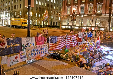 BOSTON - APR 18: Memorial from flowers set up on Boylston Street in Boston, USA on April 18, 2013. 3 people killed and over 100s injured during Boston Marathon bombing on April 15, 2013. - stock photo
