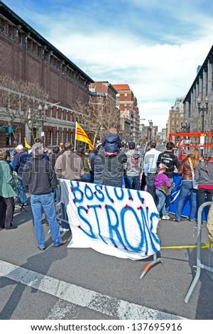 BOSTON - APR 20: People near memorial set up on Boylston Street in Boston, USA on April 20, 2013. 3 people killed and over 100s injured during Boston Marathon bombing on April 15, 2013. - stock photo