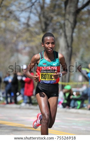 BOSTON - APRIL 18: Caroline Rotich (Kenya) races up the Heartbreak Hill during the Boston Marathon April 18, 2011 in Boston.  Caroline Kilel  (Kenya) won the womens category with 2:22:36. - stock photo
