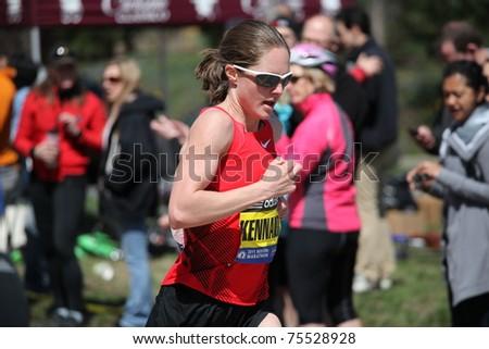 BOSTON - APRIL 18: Elite Women runners races up the Heartbreak Hill during the Boston Marathon April 18, 2011 in Boston.  Caroline Kilel  (Kenya) won the women's category with 2:22:36. - stock photo