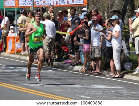 BOSTON - APRIL 16: Nearly 25000 runners participated in the Boston Marathon on a record hot day of 87 F on April 16, 2012 in Boston. Wesley Korir (Kenya) finished first with a time of 2:12:40. - stock photo