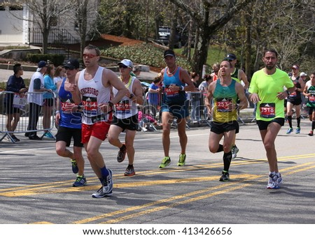 BOSTON - APRIL 18 : Nearly 27000 runners ran up Heartbreak Hill during the Boston Marathon April 18, 2016 in Boston. [public race]