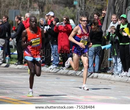 BOSTON - APRIL 18 : Ryan Hall races up Heartbreak Hill during the Boston Marathon April 18, 2011 in Boston. Geoffrey Mutai (Kenya) finished in 2:03:02. - stock photo