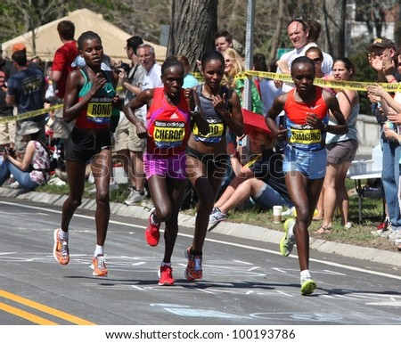 BOSTON - APRIL 16: Sharon Cherop (purple shorts) races up Heartbreak Hill during the Boston Marathon on a hot 87 degree day on April 16, 2012 in Boston. She finished first with a time of 2:31:50. - stock photo