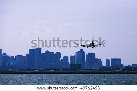 Boston arrival.  Aircraft with city background - stock photo