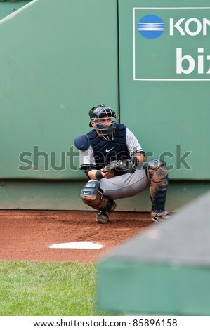 Boston - August 8: New York Yankees catcher, #17, Francisco Cervelli warms up before the game on August 8, 2011 at Fenway Park in Boston, Massachusetts. - stock photo