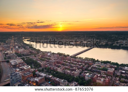 Boston Charles River sunset aerial view with urban buildings and bridge. - stock photo