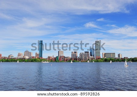 Boston Charles River with urban city skyline skyscrapers and boats with blue skyr. - stock photo