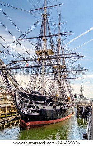 BOSTON - CIRCA MAY 2013: USS Constitution in Boston Navy Yard, USA, circa May 2013. The ship is a 3-masted heavy frigate of the US Navy, and it's the world's oldest commissioned naval vessel afloat - stock photo