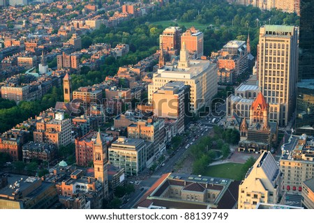 Boston city downtown aerial view with urban historical buildings at sunset. - stock photo