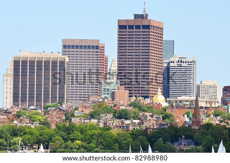 Boston Custom House and Financial district, dome of Massachusetts State House and Beacon Hill from Cambridge, Massachusetts, USA - stock photo