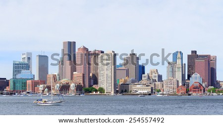 Boston downtown skyline in the morning with urban skyscrapers over sea. - stock photo