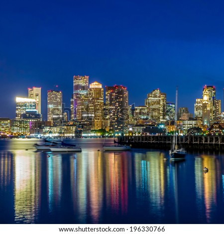 Boston downtown skyline panorama with skyscrapers over water at twilight - stock photo